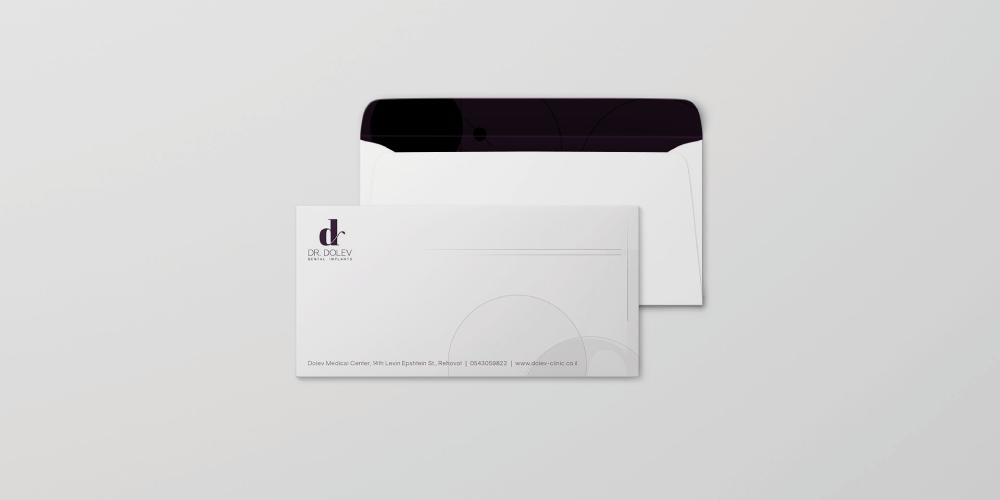 עיצוב מעטפה מיתוג מרפאות שיניים אהוי דולב
